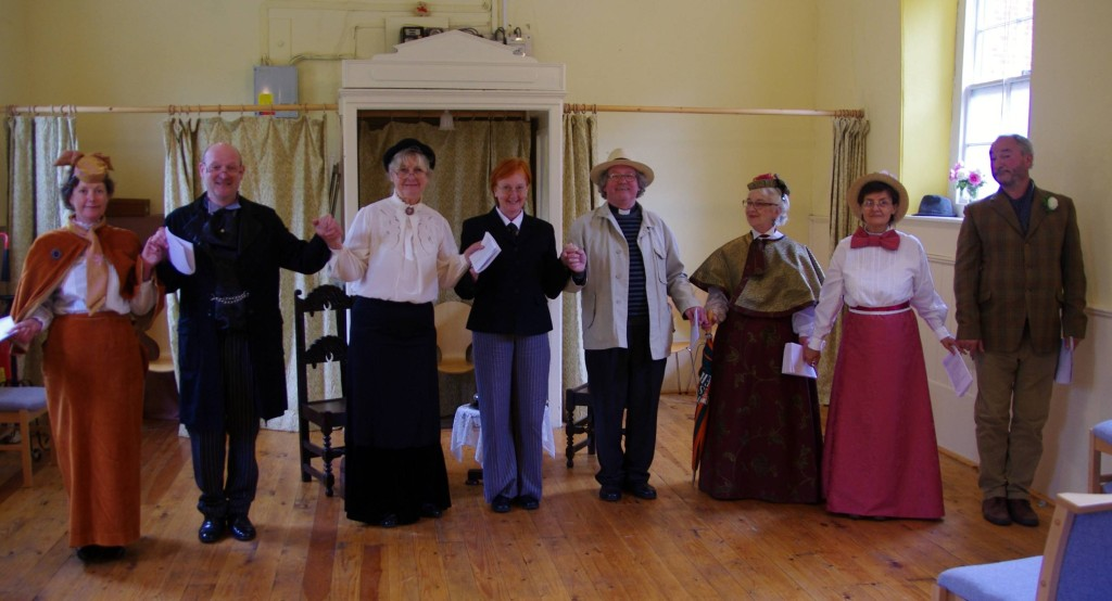 The Importance of Being Earnest cast (L-R Francesca Bingham as Gwendolen, Mark Ferrero as Jack, Jacqueline Archer as Miss Prism, Sue Hopkins as the servant, Bill Huband as Canon Chasuble, Sue Huband as Lady Bracknell, Viv Simkins as Cecily, and Mark Abbott as Algernon)